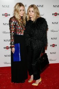 Mary-Kate iAshley Olsen podczas premiery filmu 'Nine', fot. PAF Forum/Raoul Gatchalian/starmaxinc.com